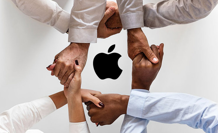 Apple technical recruitment represented by locked hands around Apple logo